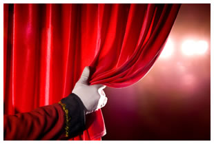 white-gloved-hand-pulling-back-red-theatre-curtain1